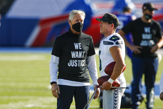 Seattle Seahawks head coach Pete Carroll, left, talks to kicker Jason Myers before an NFL football game against the Buffalo Bills Sunday, Nov. 8, 2020, in Orchard Park, N.Y. (AP Photo/John Munson)