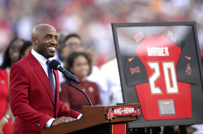 Former Tampa Bay Buccaneers player Ronde Barber smiles as he is inducted in the team's Ring of Honor during halftime of an NFL football game against the New York Giants Sunday, Sept. 22, 2019, in Tampa, Fla. (AP Photo/Jason Behnken)