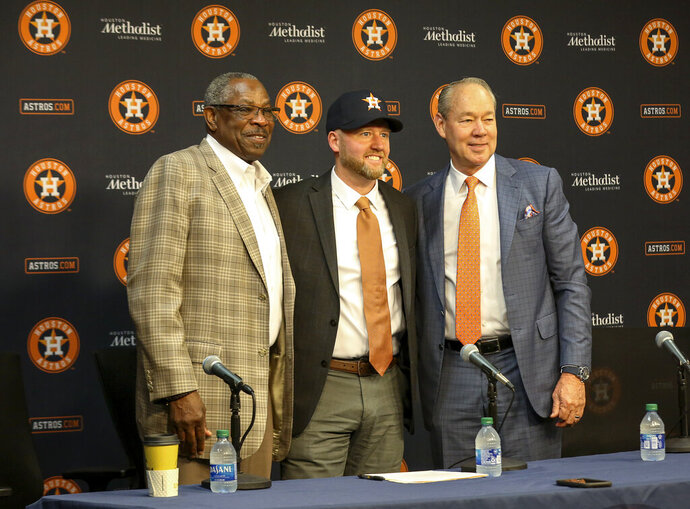 James Click, center, the newly-hired Houston Astros general manager, poses with Astros manager Dusty Baker, left, and Astros owner and chairman Jim Crane during a baseball press conference Tuesday, Feb. 4, 2020, at Minute Maid Park in Houston. (Jon Shapley/Houston Chronicle via AP)
