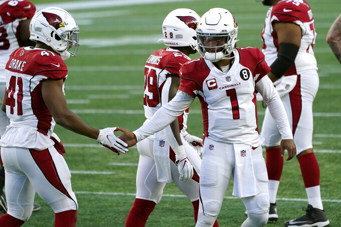 Arizona Cardinals quarterback Kyler Murray, right, congratulates running back Kenyan Drake on his touchdown against the New England Patriots in the second half of an NFL football game, Sunday, Nov. 29, 2020, in Foxborough, Mass. (AP Photo/Charles Krupa)