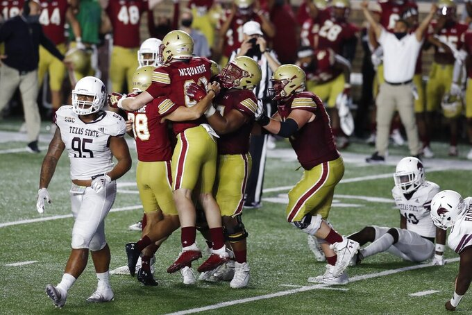 Texas State defensive lineman Nico Ezidore (95) walks off the field as Boston College players celebrate a go-ahed field goal by Aaron Boumerhi in the waning seconds of an NCAA college football game Saturday, Sept. 26, 2020, in Boston. (AP Photo/Michael Dwyer)