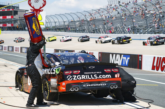 Joe Graf Jr.'s pit crew goes to work on his car during the NASCAR Xfinity Series auto race at Dover International Speedway, Tuesday, June 15, 2021, in Dover, Del. (AP Photo/Chris Szagola)