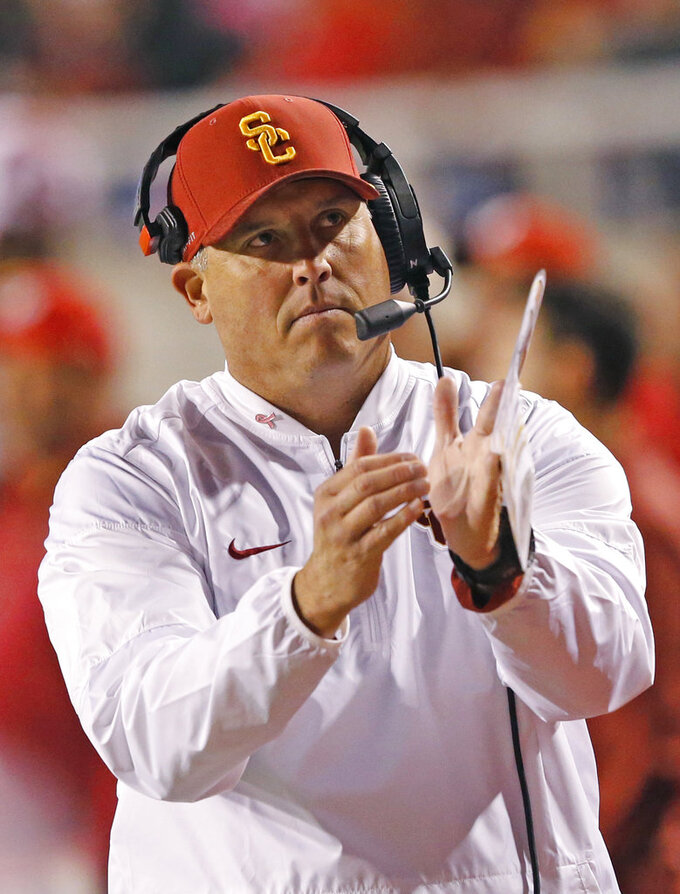 Southern California head coach Clay Helton calls for a time out in the first half during an NCAA college football game against Utah Saturday, Oct. 20, 2018, in Salt Lake City. (AP Photo/Rick Bowmer)