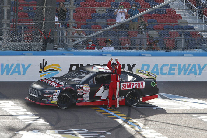 David Gilliland (4) celebrates after winning the ARCA Series auto race at Phoenix Raceway, Saturday, Nov. 7, 2020, in Avondale, Ariz. (AP Photo/Ralph Freso)