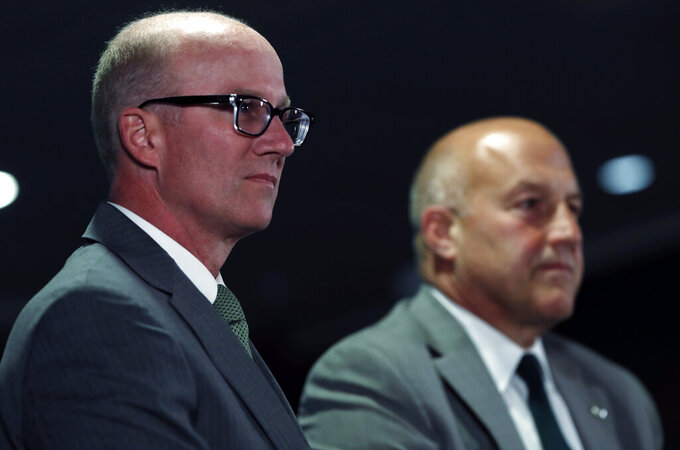 Joe Parker, left, athletic director at Colorado State University, considers a question as Steve Addazio looks on during an announcement that Addazio has been hired as the new head football coach at the school at a news conference Thursday, Dec. 12, 2019, in Fort Collins, Colo. (AP Photo/David Zalubowski)