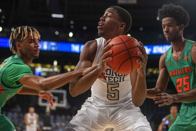 Georgia Tech forward Moses Wright (5) looks to pass the ball against Florida A&M during the first half of an NCAA college basketball game in Atlanta, Friday, Dec. 18, 2020. (Alyssa Pointer/Atlanta Journal-Constitution via AP)