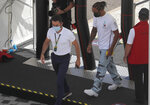 Mercedes driver Lewis Hamilton of Britain arrives ahead of the British Formula One Grand Prix at Silverstone circuit, Silverstone, England, Thursday, July 30, 2020.(AP Photo/Frank Augstein)