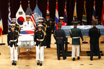 Honor guards of South Korea and the United Nations Command (UNC) carry boxes containing the remains of two servicemen killed during the 1950-53 Korean War, during a mutual repatriation ceremony at Seoul National Cemetery in Seoul, South Korea, Friday, July 13, 2018. The United States and South Korea held the ceremony to return home the remains of two servicemen - an unidentified allied soldier, presumably American, right, and a South Korean soldier. (Jeon Heon-kyun/Pool Photo via AP)