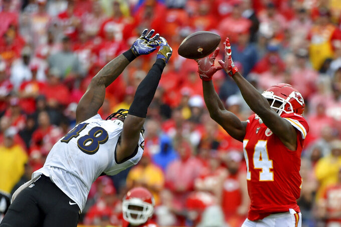 Kansas City Chiefs wide receiver Sammy Watkins (14) makes a catch over Baltimore Ravens linebacker Patrick Onwuasor (48) during the second half of an NFL football game in Kansas City, Mo., Sunday, Sept. 22, 2019. (AP Photo/Ed Zurga)