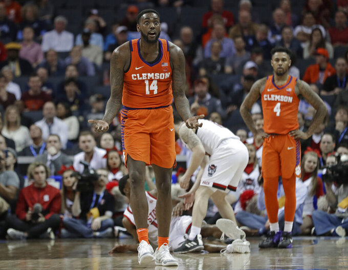 Clemson's Elijah Thomas (14) reacts after being called for his fifth foul against North Carolina State during the second half of an NCAA college basketball game in the Atlantic Coast Conference tournament in Charlotte, N.C., Wednesday, March 13, 2019. (AP Photo/Nell Redmond)