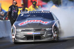 In this photo provided by the NHRA, Pro Stock driver and Minnesota native Jason Line competes in the Lucas Oil NHRA Nationals at Brainerd International Raceway in Brainerd, Minn., Sunday, Aug. 18, 2019. Line picked up the win at his home track of the speedway when he defeated Erica Enders in the final round thanks to his 6.597-second pass at 209.10 mph. (Marc Gewertz/NHRA via AP)