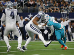 Dallas Cowboys' Dak Prescott (4) prepares to throw a pass as offensive tackle La'el Collins (71) blocks against pressure from Miami Dolphins' Taco Charlton, right, in the first half of a NFL football game in Arlington, Texas, Sunday, Sept. 22, 2019. (AP Photo/Michael Ainsworth)
