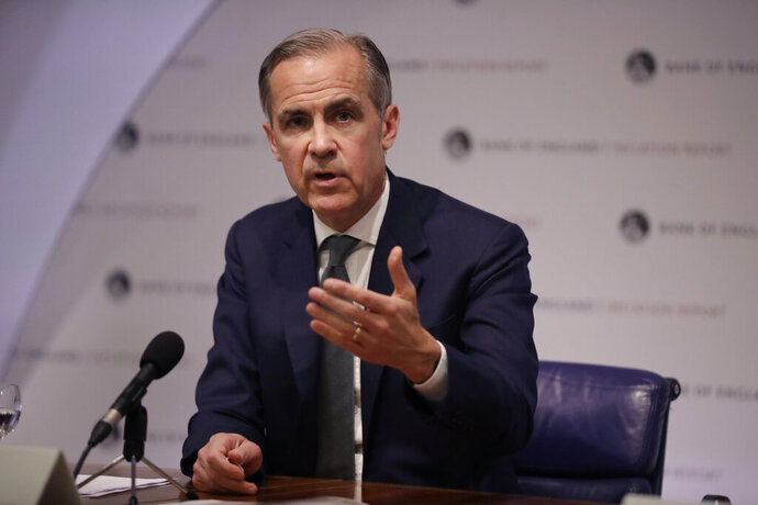 FILE - In this May 2, 2019, file photo Mark Carney the Governor of the Bank of England speaks during an Inflation Report Press Conference at the Bank of England in the City of London. The Bank of England is open to the idea of letting new payment services such as Facebook's upcoming Libra hold funds with the central bank, Carney said Thursday, June 20. (AP Photo/Matt Dunham, Pool, File)