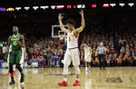 Iowa State guard Lindell Wigginton (5) celebrates in front Baylor guard Tyson Jolly (10) at the end of an NCAA college basketball game, Saturday, Jan. 13, 2018, in Ames, Iowa. Wigginton scored 30 points as Iowa State won 75-65. (AP Photo/Charlie Neibergall)