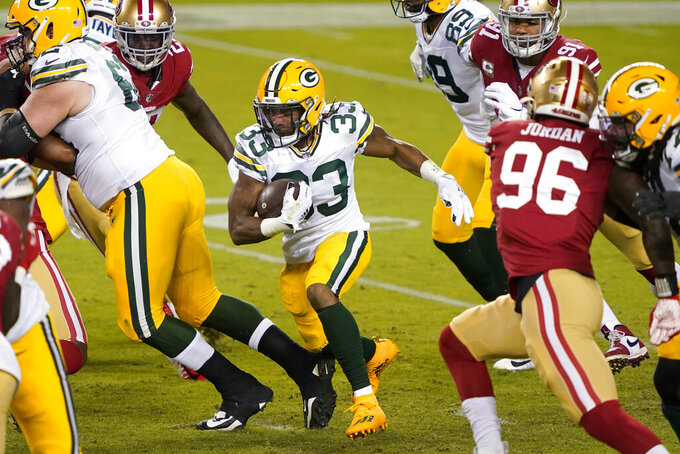 Green Bay Packers running back Aaron Jones (33) runs against the San Francisco 49ers during the first half of an NFL football game in Santa Clara, Calif., Thursday, Nov. 5, 2020. (AP Photo/Tony Avelar)