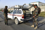 "In this Tuesday, Sept. 10, 2019, photo, Afghan National army soldiers search a vehicle at a checkpoint in Kabul, Afghanistan. President Donald Trump says U.S.-Taliban talks on ending the war in Afghanistan are ""dead,"" deeply unfortunate wording for the Afghan civilians who have been killed by the tens of thousands over almost 18 years. (AP Photo/Rahmat Gul)"