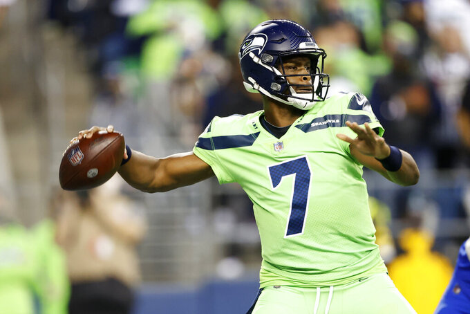Seattle Seahawks backup quarterback Geno Smith passes against the Los Angeles Rams during the second half of an NFL football game, Thursday, Oct. 7, 2021, in Seattle. Smith came in while starting quarterback Russell Wilson had a hand injury evaluated. (AP Photo/Craig Mitchelldyer)