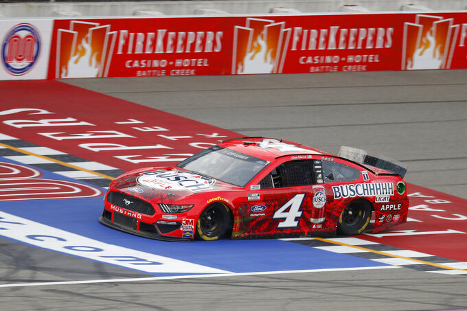 Kevin Harvick crosses the finish line during a NASCAR Cup Series auto race at Michigan International Speedway in Brooklyn, Mich., Saturday, Aug. 8, 2020. (AP Photo/Paul Sancya)