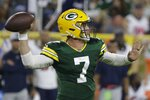 Green Bay Packers' Kurt Benkert throws during the second half of a preseason NFL football game against the Houston Texans Saturday, Aug. 14, 2021, in Green Bay, Wis. (AP Photo/Mike Roemer)