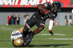 Cincinnati running back Michael Warren II (3) is tackled by Navy linebacker Hudson Sullivan (53) in the first half of an NCAA college football game, Saturday, Nov. 3, 2018, in Cincinnati. (AP Photo/John Minchillo)