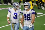 Dallas Cowboys' Garrett Gilbert (3) and Dalton Schultz (86) walk to the sideline after a pass by Gilbert was intercepted by Pittsburgh Steelers' Minkah Fitzpatrick in the end zone in the second half of an NFL football game in Arlington, Texas, Sunday, Nov. 8, 2020. (AP Photo/Ron Jenkins)