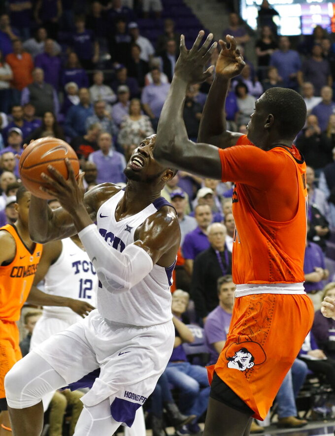 TCU forward JD Miller (15) puts up the winning shot against Oklahoma State during an NCAA college basketball game in Fort Worth, Texas, Wednesday, Feb. 6, 2019. (David Kent/Star-Telegram via AP)