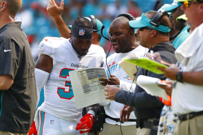 Miami Dolphins head coach Brian Flores talks to free safety Doug Middleton (36) on the sidelines, during the first half at an NFL football game, Sunday, Sept. 29, 2019, in Miami Gardens, Fla. AP Photo/Wilfredo Lee)