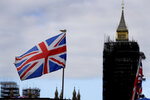"The Union flag flies above a souvenir stand in front of Big Ben in London, Friday, Oct. 16, 2020. Britain's foreign minister says there are only narrow differences remaining in trade talks between the U.K. and the European Union. But Dominic Raab insists the bloc must show more ""flexibility"" if it wants to make a deal. (AP Photo/Kirsty Wigglesworth)"