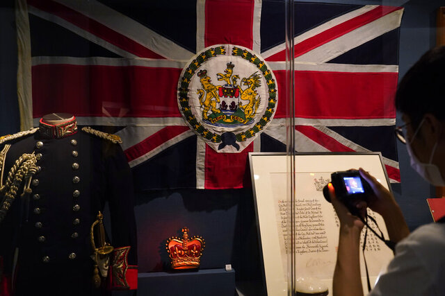 The standard and uniform of the former British Governors of Hong Kong, are displayed at the exhibition