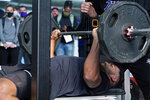 Tulsa linebacker Zaven Collins bench presses during NFL football pro day Friday, April 2, 2021, in Tulsa, Okla. (AP Photo/Sue Ogrocki)