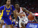 North Carolina State's Markell Johnson (11) drives past Pittsburgh's Justin Champagnie (11) during the second half of an NCAA college basketball game at PNC Arena in Raleigh, N.C., Saturday, Feb. 29, 2020. (Ethan Hyman/The News & Observer via AP)