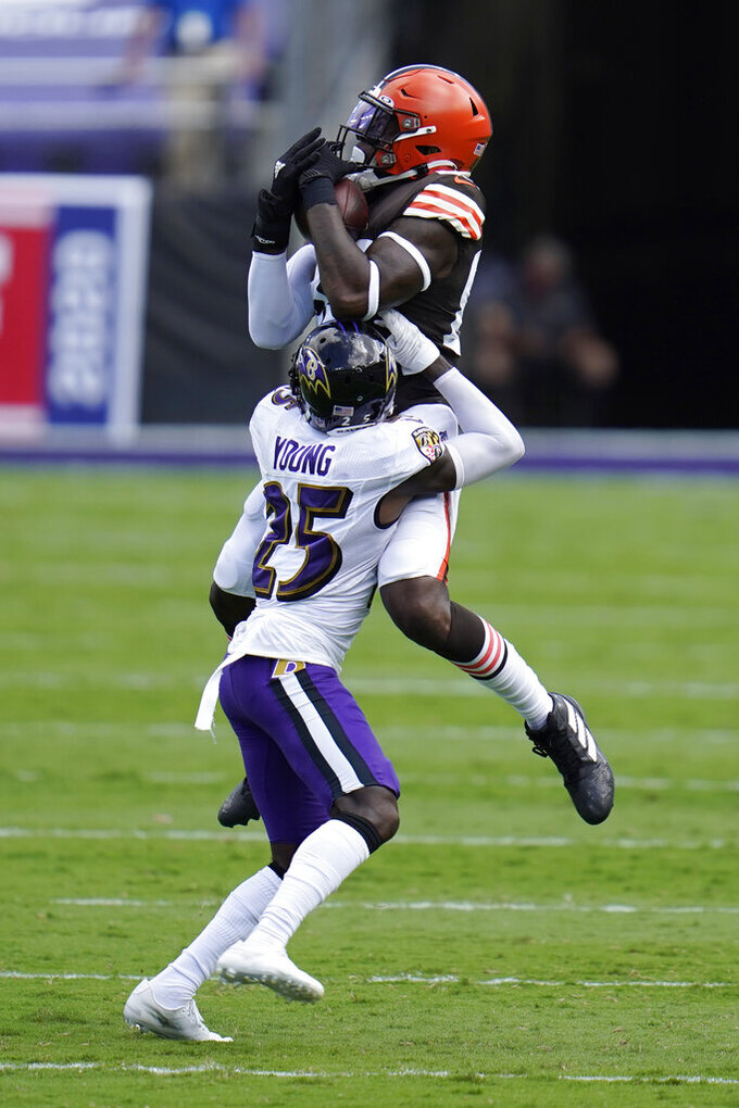 Cleveland Browns tight end David Njoku (85) makes a catch over Baltimore Ravens cornerback Tavon Young (25), during the first half of an NFL football game, Sunday, Sept. 13, 2020, in Baltimore, MD. (AP Photo/Julio Cortez)
