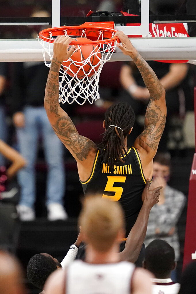 Missouri forward Mitchell Smith (5) dunks the ball against Texas A&M during the second half of an NCAA college basketball game Saturday, Jan. 16, 2021, in College Station, Texas. (AP Photo/Sam Craft)