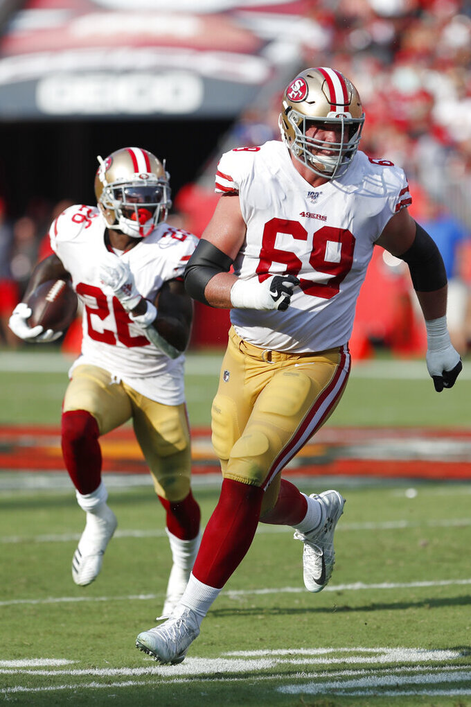 San Francisco 49ers offensive tackle Mike McGlinchey (69) looks to block for San Francisco 49ers running back Tevin Coleman (26) against the Tampa Bay Buccaneers during the first half an NFL football game, Sunday, Sept. 8, 2019, in Tampa, Fla. (AP Photo/Mark LoMoglio)