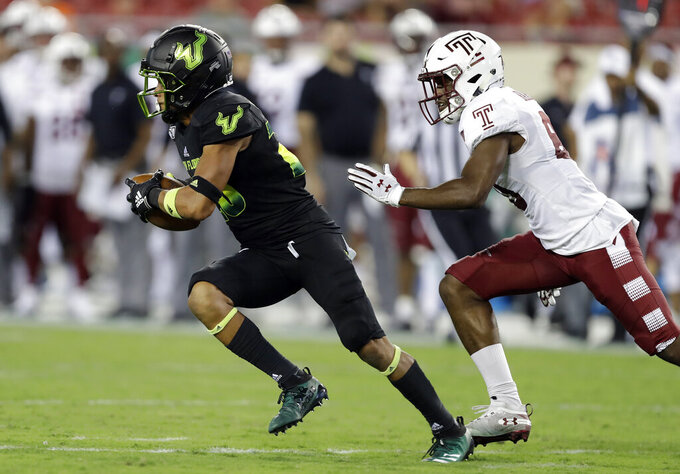 South Florida defensive back Bentlee Sanders, left, outruns Temple wide receiver Jose Barbon (80) after an interception during the second half of an NCAA college football game Thursday, Nov. 7, 2019, in Tampa, Fla. (AP Photo/Chris O'Meara)