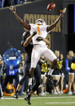Tennessee wide receiver Marquez Callaway (1) cannot hold onto a pass as he is defended by Vanderbilt safety LaDarius Wiley in the second half of an NCAA college football game Saturday, Nov. 24, 2018, in Nashville, Tenn. (AP Photo/Mark Humphrey)