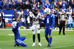 Indianapolis Colts kicker Adam Vinatieri (4) and punter Rigoberto Sanchez (8) react in front of Denver Broncos' Isaac Yiadom (26) after Vinatieri kicked a winning field during the second half of an NFL football game, Sunday, Oct. 27, 2019, in Indianapolis. (AP Photo/AJ Mast)