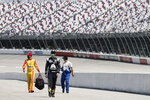 Drivers walk to their cars for the start of the NASCAR Cup Series auto race Sunday, May 17, 2020, in Darlington, S.C. (AP Photo/Brynn Anderson)