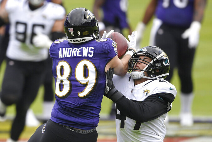 Baltimore Ravens tight end Mark Andrews (89) makes a catch against Jacksonville Jaguars linebacker Joe Schobert (47) during the first half of an NFL football game, Sunday, Dec. 20, 2020, in Baltimore. (AP Photo/Nick Wass)