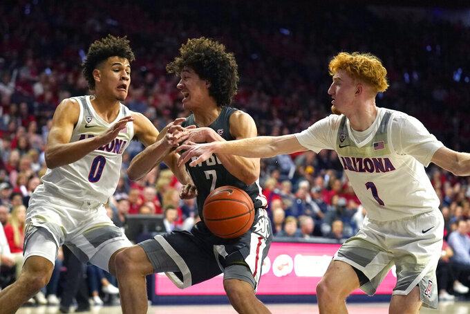 Arizona forward Josh Green (0) and Nico Mannion pressure Washington State forward CJ Elleby (2) in the first half of an NCAA college basketball game Thursday, March 5, 2020, in Tucson, Ariz. (AP Photo/Rick Scuteri)