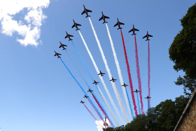 French Alpha jets of the Patrouille de France and the UK Royal red arrows aerobatic planes spraying lines of smoke in the colors of the French flag fly over the Mont-Valerien, a memorial for the French who fought against the Nazis and those who were killed by the occupying forces, in Suresnes, west of Paris, Thursday, June 18, 2020 at the start of the traditional annual ceremony of commemoration for the 80th anniversary of Charles de Gaulle's radio appeal to his countrymen to resist Nazi occupation during WWII. French President Emmanuel Macron is traveling to London to mark the day that De Gaulle delivered his defiant broadcast 80 years ago urging his nation to fight on despite the fall of France. In a reflection of the importance of the event, the trip marks Macron's first international trip since France's lockdown amid the COVID-19 pandemic. (Ludovic Marin/Pool via AP)