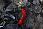 I this Sept. 8, 2019 photo, an abandoned high heel shoe lays in the mud in the aftermath of Hurricane Dorian in an area called The Mudd, in Marsh Harbor, Abaco Island, Bahamas. Dorian was the most powerful hurricane in the northwestern Bahamas' recorded history. (AP Photo/Fernando Llano)