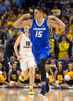 Creighton forward Martin Krampelj reacts after making a basket against Marquette during the first half of an NCAA college basketball game Sunday, March 3, 2019, in Milwaukee. (AP Photo/Darren Hauck)