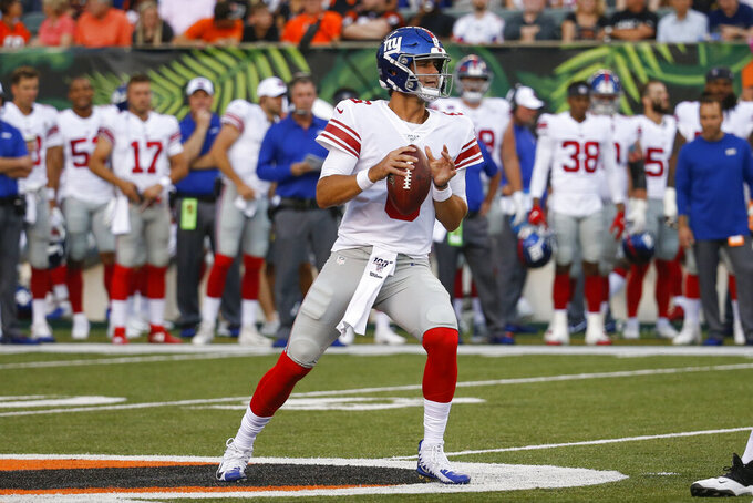 New York Giants quarterback Daniel Jones looks for a receiver during the first half of the team's NFL preseason football game against the Cincinnati Bengals, Thursday, Aug. 22, 2019, in Cincinnati. (AP Photo/Frank Victores)