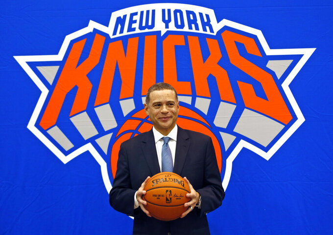 FILE - In this July 17, 2017, file photo, New York Knicks general manager Scott Perry poses for a picture after a news conference in Greenburgh, N.Y. Scott Perry will remain general manager of the New York Knicks after agreeing to a new one-year deal with the team Wednesday, April 29, 2020. (AP Photo/Seth Wenig, File)