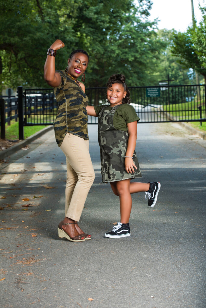 In this recent photo, Shaquita Estes, left, and her 8-year-old daughter, Lexie, pose in Newnan, Ga. Mother and daughter pen children's book about breast cancer. (Laurel Huster/The Newnan Times-Herald via AP)