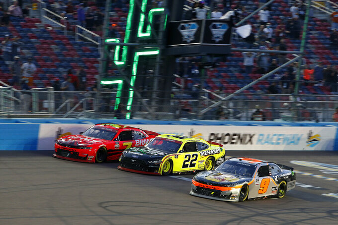 Justin Allgaier (7), Austin Cindric (22) and Noah Gragson (9) race side by side for the lead through Turn 4 on the final lap of the NASCAR Xfinity Series auto race at Phoenix Raceway, Saturday, Nov. 7, 2020, in Avondale, Ariz. (AP Photo/Ralph Freso)
