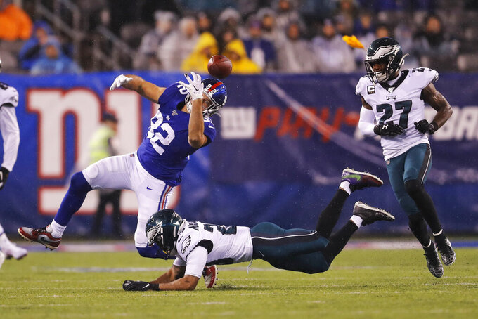 New York Giants tight end Kaden Smith (82) loses control of the ball in front of Philadelphia Eagles free safety Rodney McLeod (23) in the second half of an NFL football game, Sunday, Dec. 29, 2019, in East Rutherford, N.J. (AP Photo/Adam Hunger)