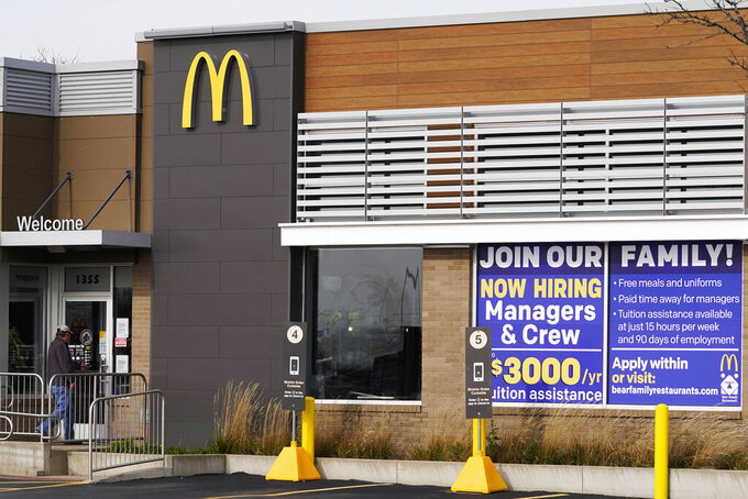 FILE - In this Nov. 19, 2020, file photo, a hiring sign is displayed outside of McDonald's in Buffalo Grove, Ill. On Wednesday, April 14, 2021, McDonald's said the company will mandate worker training to combat harassment, discrimination and violence in its restaurants worldwide starting in 2022.  (AP Photo/Nam Y. Huh, File)