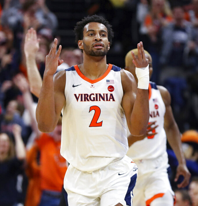 Virginia guard Braxton Key (2) reacts after shooting a 3-point basket during an NCAA college basketball game against Duke Saturday, Feb. 29, 2020, in Charlottesville, Va. (AP Photo/Andrew Shurtleff)